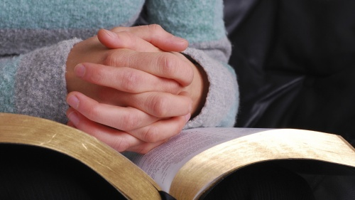 A person holding a Bible.